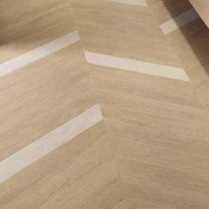 Carrelage Nid Natural herringbone mat.